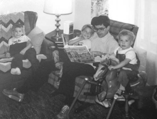 Alan with boys reading