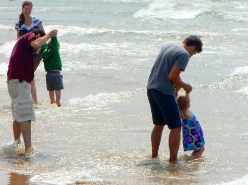 Playing at beach with children
