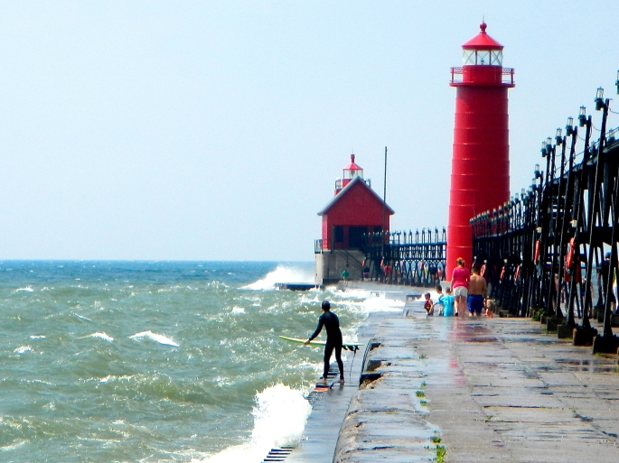 Surfing off pier at Grand Haven