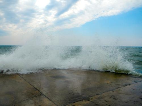 Waves splashing on pier