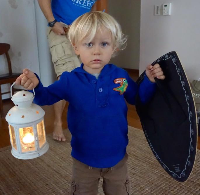 Boy with lantern and shiel