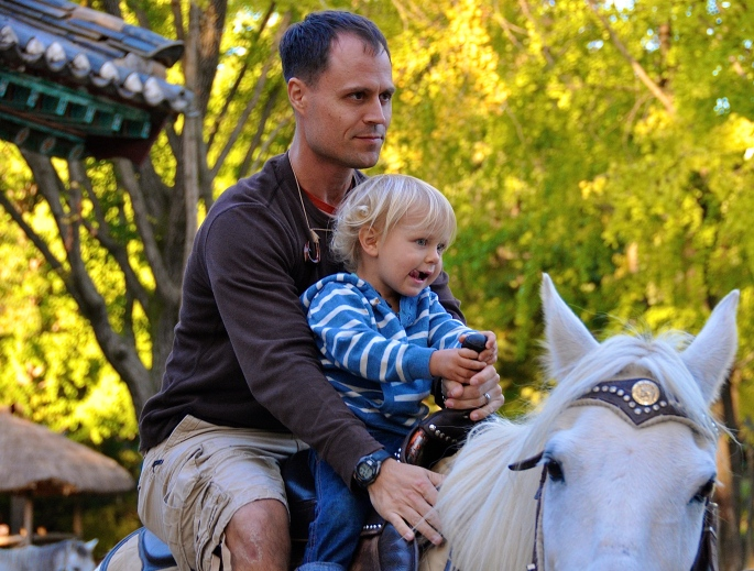 Father and son on horse