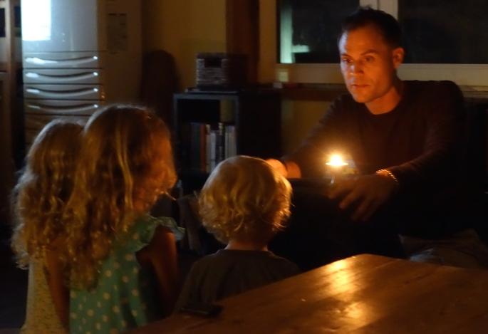 Father instructing children