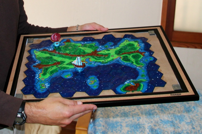 Mike holding Game board and pieces