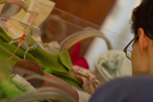 Father watching over preemie