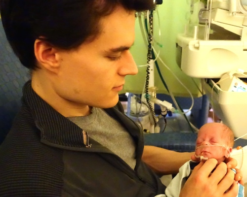 Father holding preemie