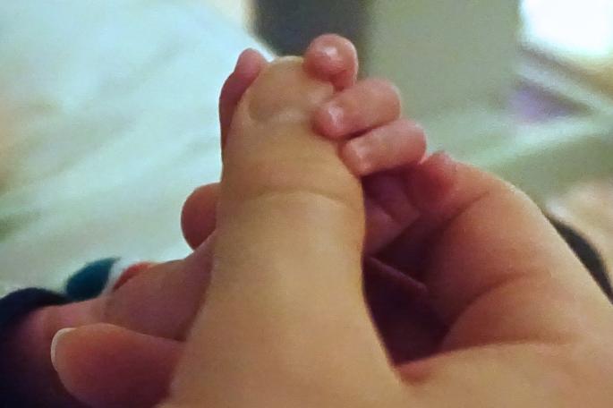 Holding preemie's hand