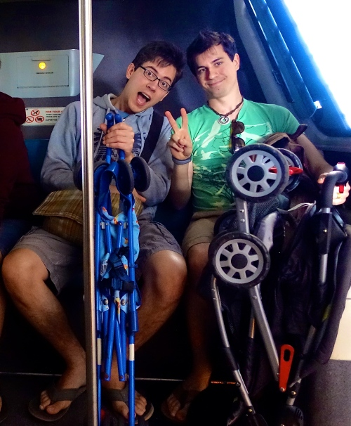 Uncles with strollers on monorail