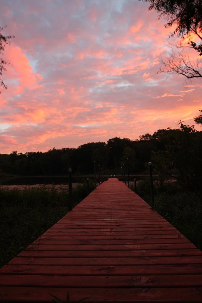 Sunrise. Dock in lake