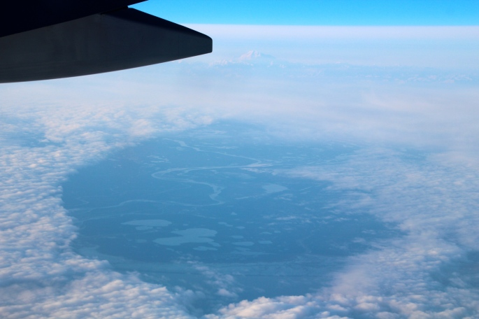 Flying over clouds and lake