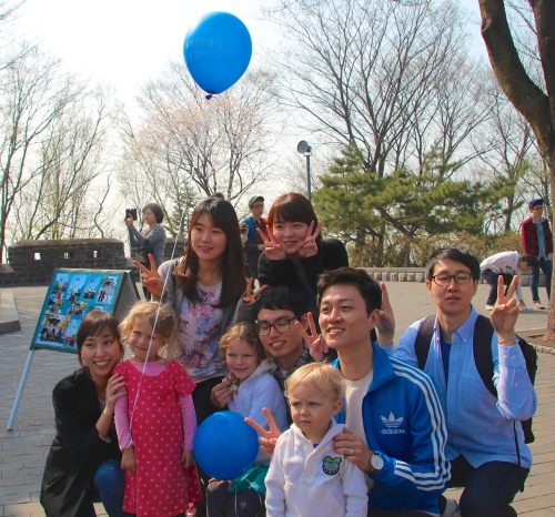 Kids with Asians students by Seoul Tower