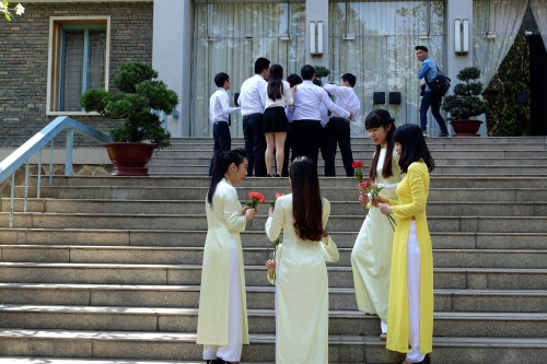 Wedding party on steps of Reconcilliation Palace. Vietnam