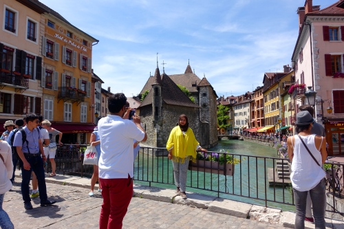 Couple on bridge in Annecy, France