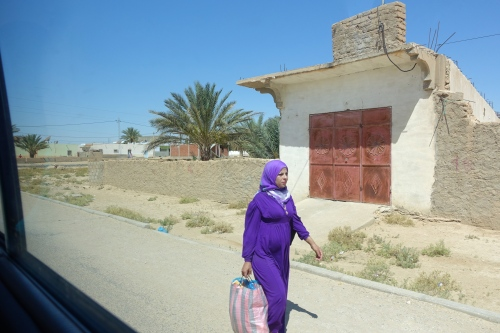 Lady carrying bag. Tunisia