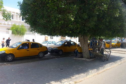 Taxi Stand. Men waiting in Tunisia