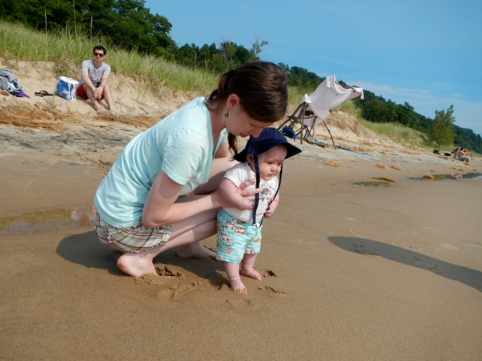 Baby checking out sand at Hoffmaster State Park