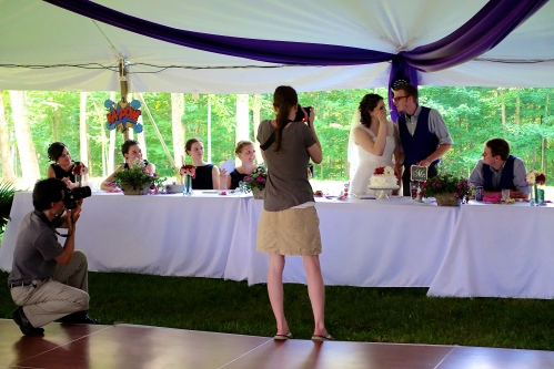 Bride feeding cake to groom