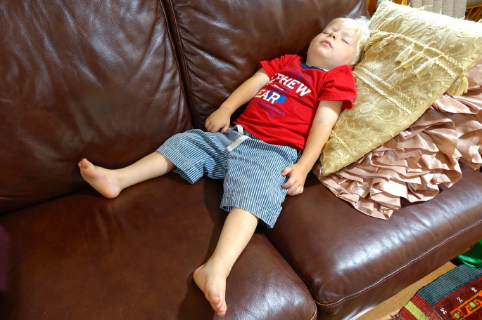 Child asleep on couch