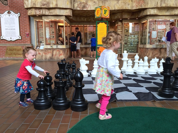 Children playing with giant chess pieces. 2