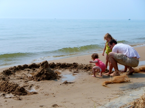 Daddy's Little Helper building a sandcastle at Hoffmaster State Park