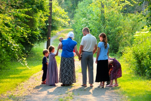 Family walking down a lane