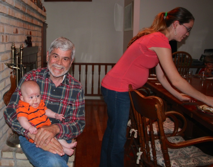 Grandpa helping by holding grandson