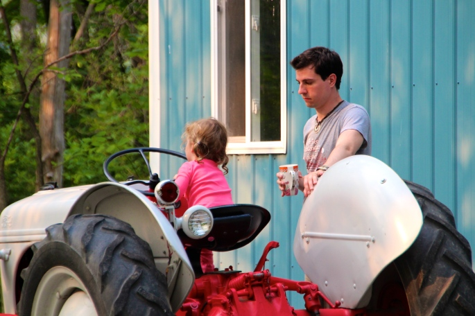 Joel with Amelie on tractor