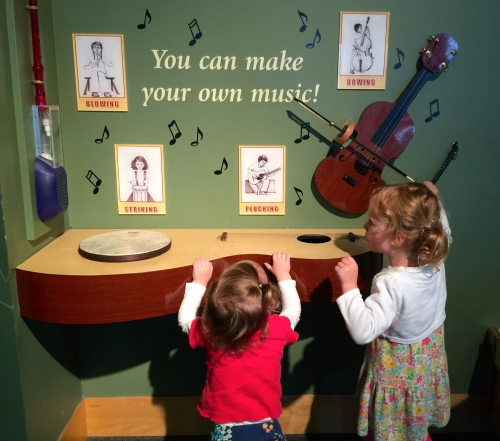 Playing with Musical Instruments at Playing with legos at the Carousel at Grand Rapids Public Museum