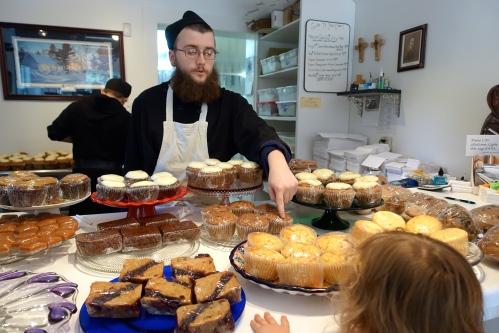 A monk describing treats at the Jampot Bakery
