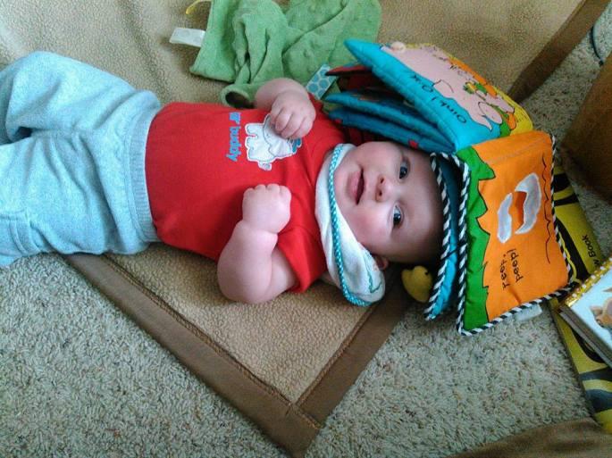 Baby under a book