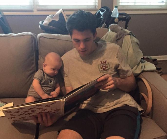 Daddy reading to Baby