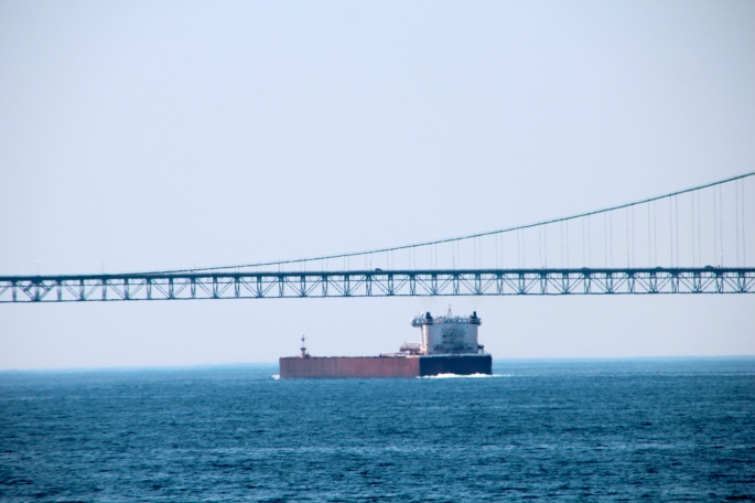 Freighter Passing Under Mackinac Bridge