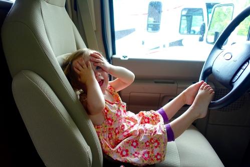 Little girl at steering wheel