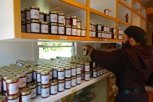 Monk arranging jams at the Jampot
