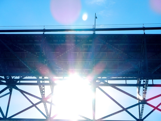 Sun shining under Mackinac Bridge