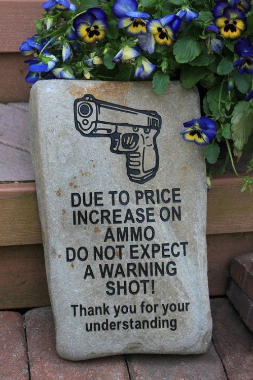 Warning sign about getting shot on sight