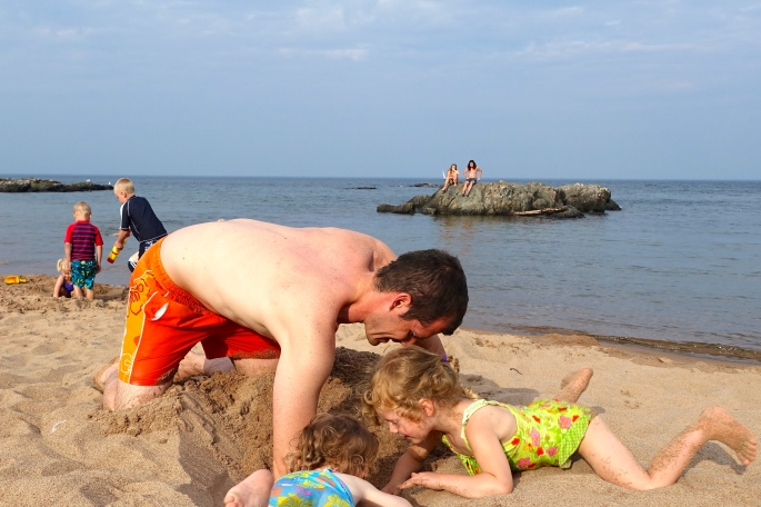 Digging in the sand at McCarty's Cove
