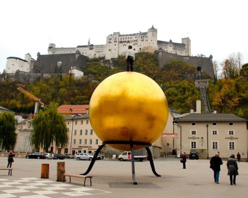 Man on Golden Globe. Salzburg
