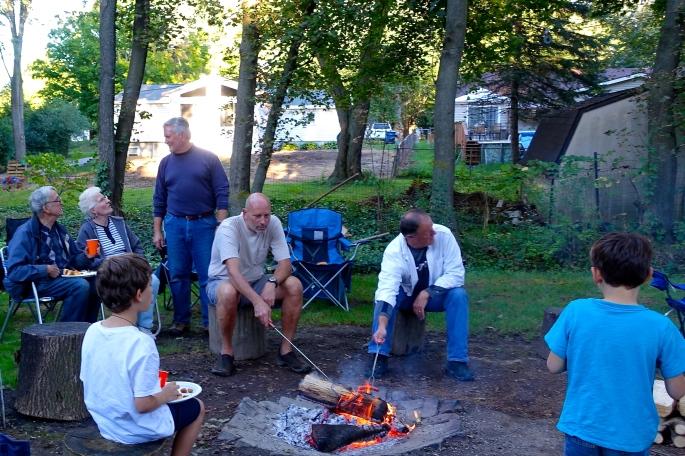 Roasting hotdogs around the fire