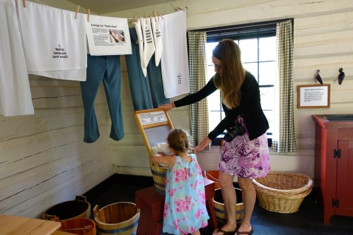 Using an Old-fashioned scrub board at Fort Wilkins