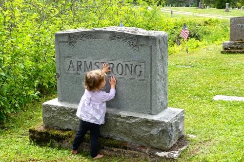 Baby at gravestone