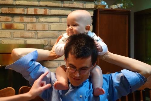 Baby riding Dad's shoulders
