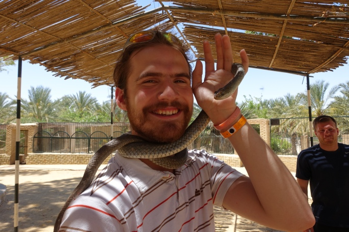 Silas with a snake at a Tunisian Zoo