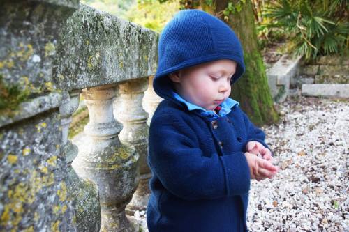 Baby playing with stones