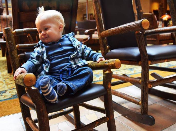 Baby rocking in a rocking chair