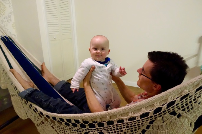 Hammock. Baby and Father swinging