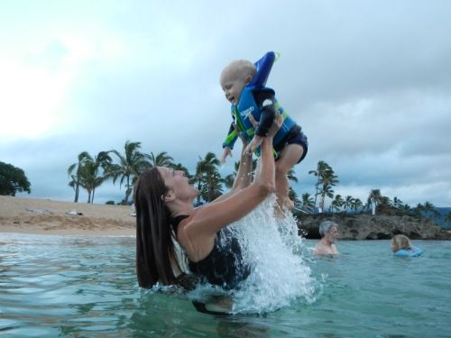 Playing with baby in ocean