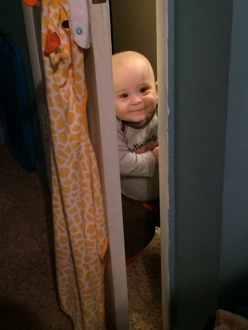 Baby Peeking Through Door