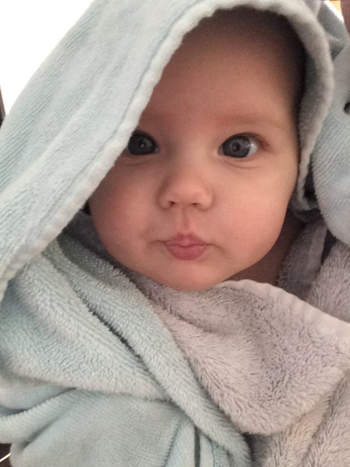 Baby wrapped in bath towel