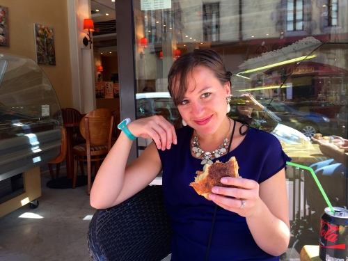 Shannon enjoying one of the world's best chocolate croissants at Aux Cygnes Gourmands. Annecy France